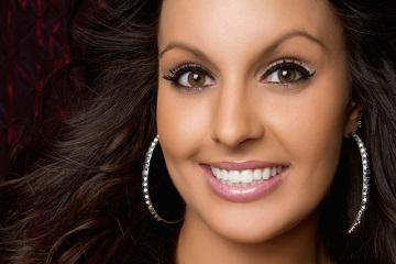 Woman with dark hair smiling | 95032 Dentist