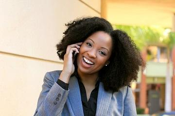 Woman talking on phone smiling | Dentist Los Gatos CA