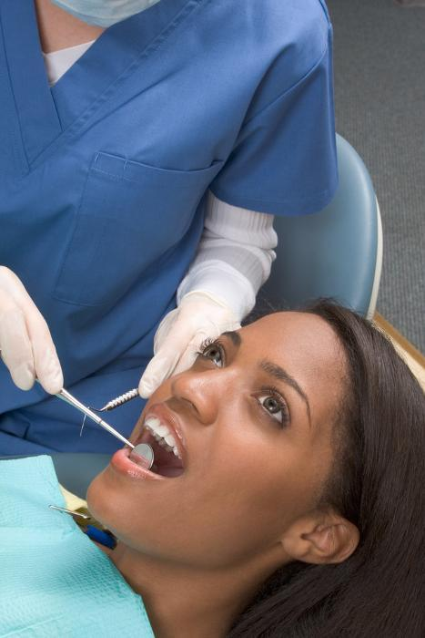 Woman getting her teeth cleaned | Dentist Los Gatos CA