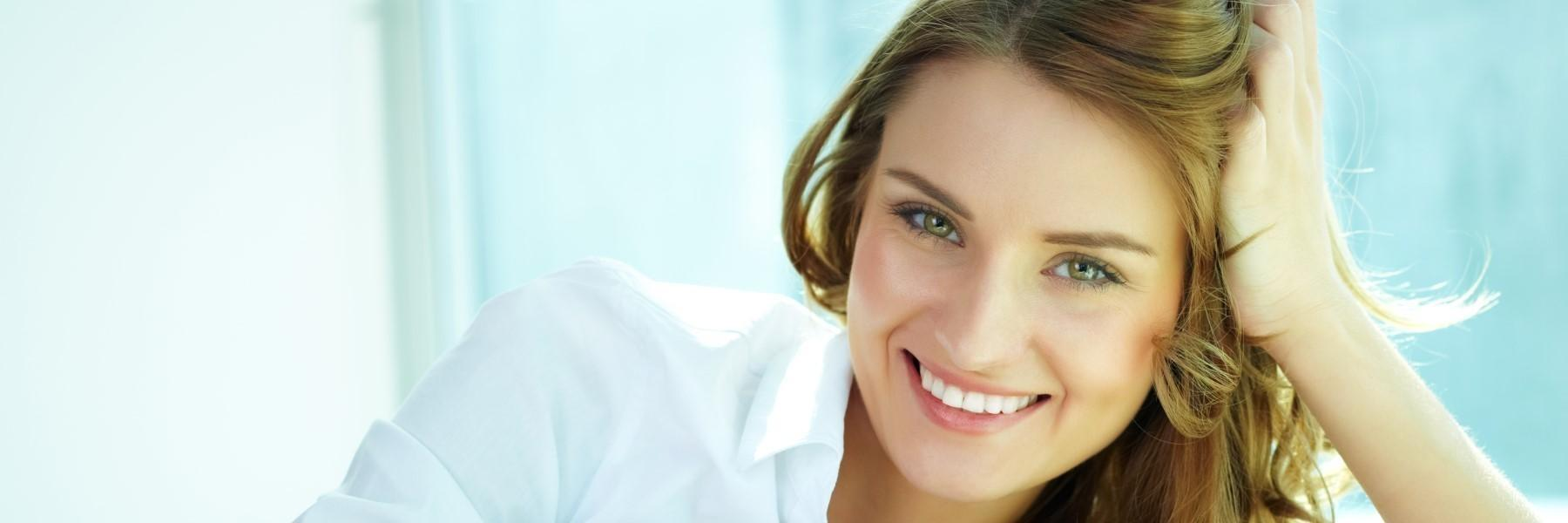 Woman smiling with white shirt | Dentist Los Gatos CA