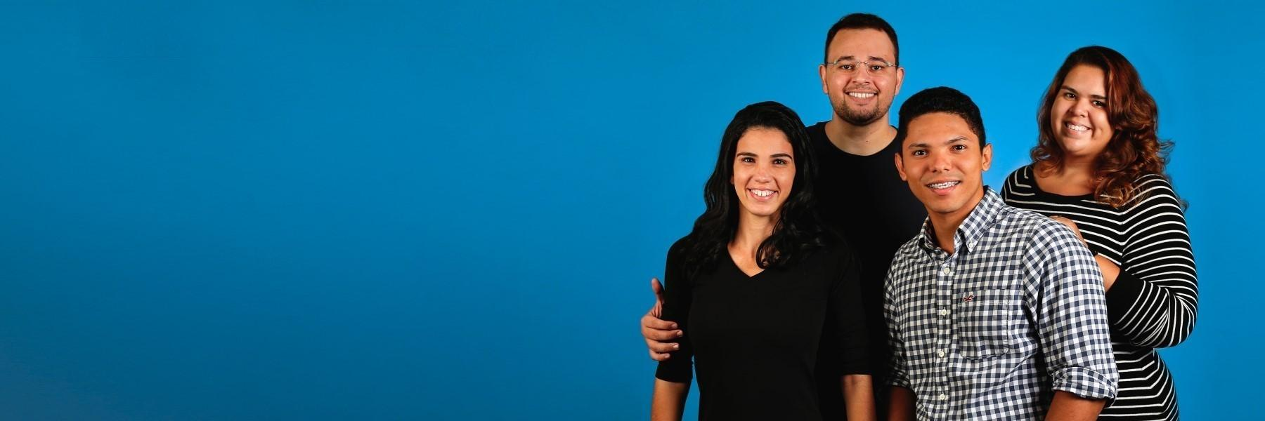 Mother, father, daughter, and son smiling with blue background | Dentist 95032